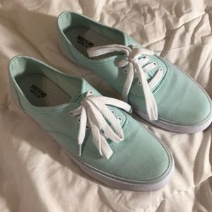 Teal tennis shoes